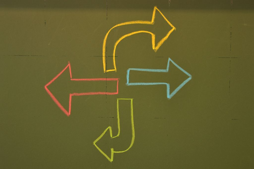 Colorful arrows on a chalkboard pointing in different directions